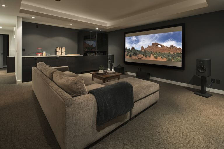 movie-playing-on-projection-screen-in-home-theater-915093896-5bdb7eb0c9e77c0026d2970f-2